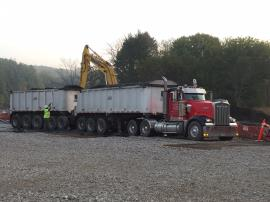Contaminated material is loaded into large dump trucks for transport to an EPA approved landfill for disposal.