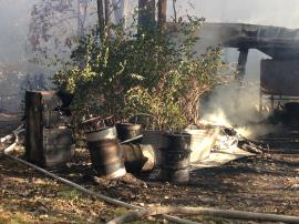 Heat from the October 20, 2015 barn fire burned plastic and wooden overpack containers off the five metal potassium vessels