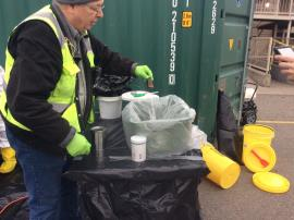 EPA contractor conducting inventory of elemental mercury containers recovered during the response
