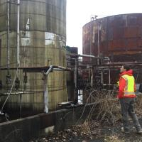 EPA OSC assesses ASTs in large secondary containment in Tank Farm area.