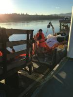 State crews adjust containment boom to prepare for on-water operations.