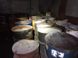 Drums containing foundry sand
