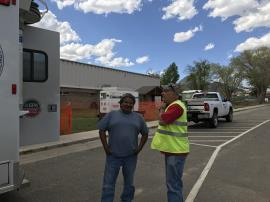 EPA's On Scene Coordinator and a representative of the Ute Mountain Ute Tribe discussing site operations.