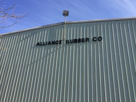 Western Exterior Wall of Warehouse Building. Alliance Rubber Co Sign. Taken during OEPA Site Assessment.