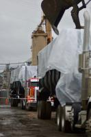 Line of trucks in the process of being filled with debris from the temporary repository. Photo taken from River Street.