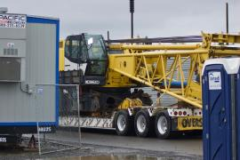 AAC trucks the crane chassis off site.