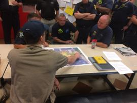 Local emergency response agencies attend the Site Contingency Plan meeting with EPA OSC Renninger