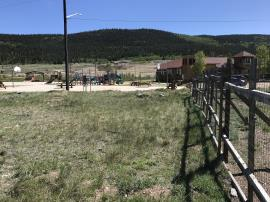 View eastward across site area toward Middle Fork of South Platte River.  Alma Town Hall in background.