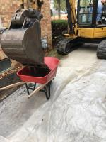 Excavating contaminated soil from the side yard of Property 11