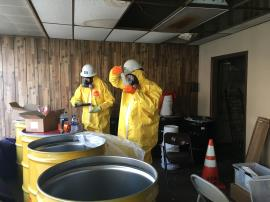 Removal contractors donning Level C PPE