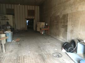 Backroom of the building upon completion of drum and container removal.