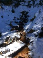 View of the draining Jumbo Mine adit from the collapsed section of the wooden building on site.<br />Date Taken: 10/10/2017<br />Category: Site Photo<br />Latitude: 39.597914<br />Longitude: -105.853358<br />Tags: Original Conditions