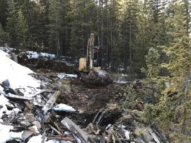 Excavator working at toe of waste rock pile constructing channel.<br />Date Taken: 10/11/2017<br />Category: Site Photo<br />Latitude: 39.5984858<br />Longitude: -105.8538775<br />Tags: Construction Activities