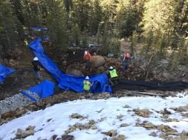 Channel liner being installed at lower edge of waste rock pile. Looking down from waste rock pile<br />Date Taken: 10/16/2017<br />Category: Site Photo<br />Latitude: 39.5983627<br />Longitude: -105.853919<br />Tags: Construction Activities