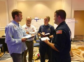 EPA Planning Section Chief Matt Huyser (left) and EPA Unified Commander Ben Franco (center) brief U.S. Coast Guard members on EPA activities at the Unified Command in Miami. EPA teams are leading land-based assessment and response actions, conducting inland assessment and looking for orphan containers as part of the ongoing Hurricane Irma response.