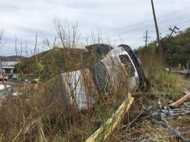 At assessment of regulated facility: Tractor Trailer blown off road by Irma along with Power Lines St Thomas USVI