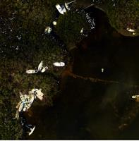 A satellite image from the National Oceanic and Atmospheric Administration (NOAA) displays vessels damaged and sunken in the aftermath of Hurricane Irma in Marathon Key, Florida. Hundreds of vessels have been reported damaged or have sunk as a result of Hurricane Irma's force. Teams consisting of federal and state response members are assessing the potential risk of pollution from these vessels. EPA teams will lead land-based assessment and response actions, conducting inland assessment and looking for orphan containers. (U.S. Coast Guard photo.)