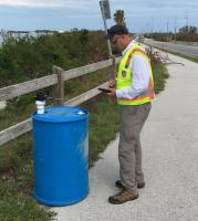 EPA OSC Richard Jardine, EPA is assessing an isolated drum on HWY1, Marathon, FL. Photo taken by Chris, Jones, START Contractor (TTEMI).
