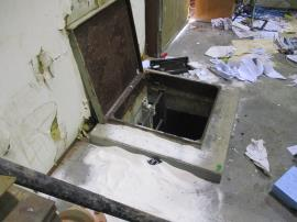 Access hatch to the clear well at the treatment plant that was vandalized. Powder around the hatch was the filter agent that was dumped into the well.