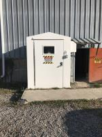 Vandalized shed containing chlorine tanks.