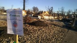 A sign in Santa Rosa's Coffey Park neighborhood signals that this property has been cleared of hazardous waste by EPA.