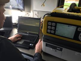 START analyzes Tedlar bag vapor samples using a Hapsite portable GC/MS analyzer inside the Seattle Comms Truck. Facing northwest. Samples were collected inside the house and from three crawlspace access points.