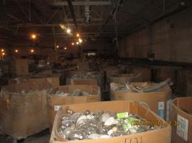 Cubic yard boxes of HID bulbs staged in zone D prior to being prepared for transport and shipping.