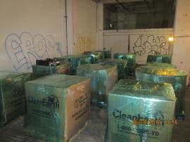 13 cubic yard boxes of batteries that have been prepared for transport and recycling staged in zone A.