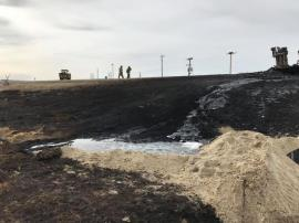 Highway shoulder after fire had been extinguished.  Note sand placed by UDOT in an attempt to contain the crude and keep it from entering stream. Photo Credit: Wasatch County Health.