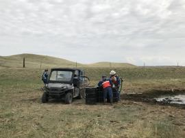 Crews utilized a UTV equipped with a recovery system to access oil in difficult to reach locations around the stock pond.