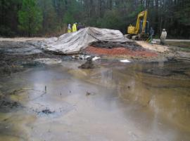 Containment pond construction