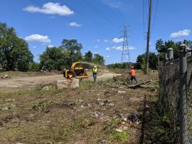 EPA ERRS contractor clears and chips brush on-site.