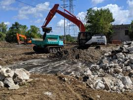 EPA ERRS contractor excavates and consolidates material into stockpiles on-site pending off-site transportation and disposal