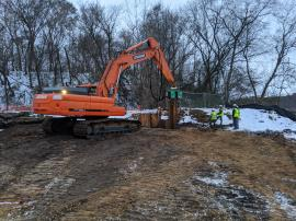 EPA ERRS contractor drives sheet piling for LNAPL interceptor trench west wing wall