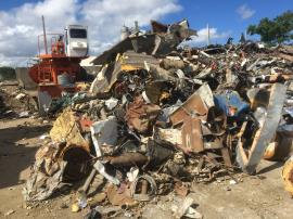 Partial view of scrap metal piles on Site.