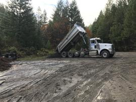 Delivery of rock to be used for access road restoration and other site needs