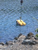 Buoyancy testing the Remotely Operated Vehicle before its deployed to assess sunken drums in Wallowa Lake.