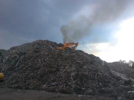 Excavator on pile attending to burning material; May 29, 2019 (Photo from SC DHEC)