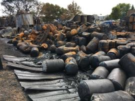 An estimated 500 drums were impacted by the fire