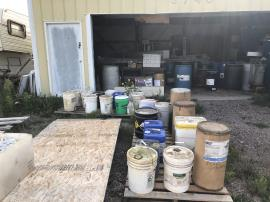 Staged chemical waste for EPA START contractor to perform assessment, inventory and sampling of containers and drums in the garage. <br />Date Taken: 9/17/2019<br />Category: Site Photo<br />Latitude: 44.1368861111111<br />Longitude: -103.132972222222<br />Tags: