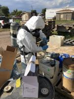 EPA START contractor sampling unknown chemical waste containers for hazard categorization testing.<br />Date Taken: 9/17/2019<br />Category: Site Photo<br />Latitude: 44.1372611111111<br />Longitude: -103.133361111111<br />Tags: