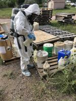EPA START contractor sampling chemical waste containers for hazard characterization testing.<br />Date Taken: 9/17/2019<br />Category: Site Photo<br />Latitude: 44.1367805555556<br />Longitude: -103.133019444444<br />Tags: