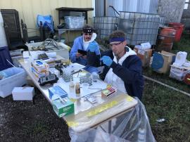 EPA START contractor performing hazard characterization testing on unknown samples collected from chemical waste containers and drums. <br />Date Taken: 9/18/2019<br />Category: Site Photo<br />Latitude: 44.1368638888889<br />Longitude: -103.132994444444<br />Tags: