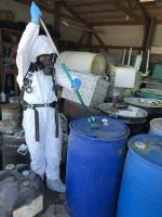 EPA START contractor sampling chemical waste drum for hazard characterization testing. <br />Date Taken: 9/18/2019<br />Category: Site Photo<br />Latitude: 44.1368555555556<br />Longitude: -103.132933333333<br />Tags: