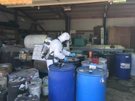 EPA START contractor opening chemical waste drum for hazard characterization sampling and testing. <br />Date Taken: 9/18/2019<br />Category: Site Photo<br />Latitude: 44.1369166666667<br />Longitude: -103.13285<br />Tags: