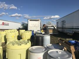 EPA ERRS contractors labeling drums for off-site transportation. <br />Date Taken: 10/21/2019<br />Category: Site Photo<br />Latitude: 44.1379555555556<br />Longitude: -103.133094444444<br />Tags: