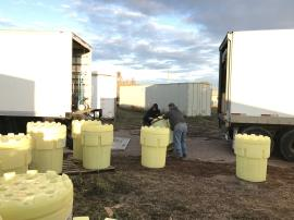 EPA ERRS contractors loading over packed drums for off-site transportation. <br />Date Taken: 10/22/2019<br />Category: Site Photo<br />Latitude: 44.1369944444444<br />Longitude: -103.132819444444<br />Tags: