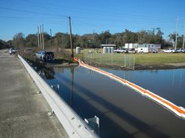 Hard and adsorbent boom at Hwy 336 bridge in 201 canal.<br />Date Taken: 12/6/2019<br />Category: Site Photo<br />Latitude: 29.9753125386503<br />Longitude: -93.9449089156748<br />Tags:
