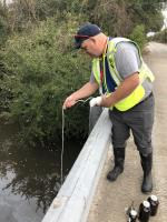 OSC Loesel collects sample from the Orchard Avenue bridge (location TPC-01).<br />Date Taken: 11/30/2019<br />Category: 20191130 - Water Sampling<br />Latitude: 29.973125<br />Longitude: -93.9300166666667<br />Tags: