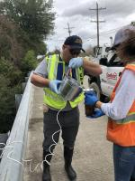 OSC Loesel transfers sample into sample container at Orchard Avenue bridge (TPC-01).<br />Date Taken: 11/30/2019<br />Category: 20191130 - Water Sampling<br />Latitude: 29.9730805555556<br />Longitude: -93.9300222222222<br />Tags: